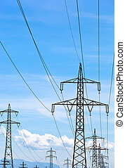 power line - a high voltage power pylons against blue sky
