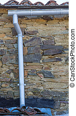 old gutter - detailed view of gutter over old stone...