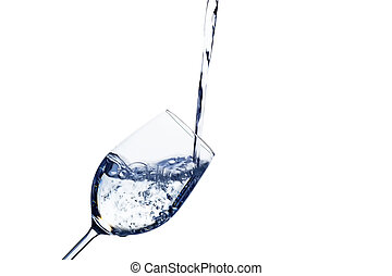 water is introduced into a glass of water - pure, clean...