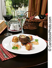 Steak with potato, place setting