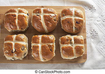 Six Hot Cross Buns - Six hot cross buns on a wooden cutting...