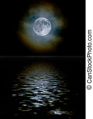 Harvest moon through light clouds with a water reflection -...