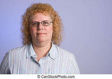 Middle aged woman - studio shot of middle aged woman with...