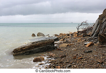Rocky seashore in a rainy weather, Slovenia - Rocky...
