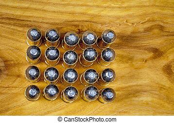Many 45 caliber bullets pattern