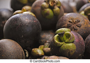 Close-up of exotic Mangosteen fruit - Tropical Fruits