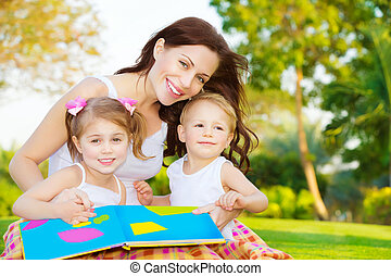 Happy family reading book - Image of cute young female with...