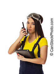 walkie-talkie in womans hand, isolated on white - Woman with...