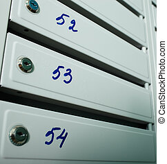 Mailboxes with flat numbers. - Gray blue metallic mailboxes...