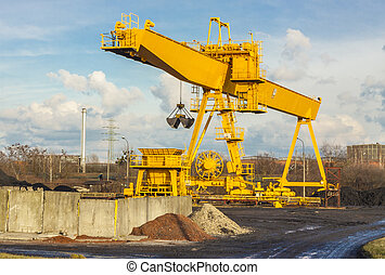Yellow gantry crane - Yellow gantry crane on coal site in...