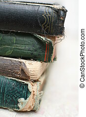 Ancient Books - close-up of a stack of old books, very...
