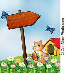 A cat beside an arrow board