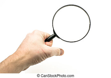 Magnifying glass - Hand holding a magnifying glass