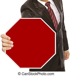 Businessman With Blank Stop Sign - A man in business attire...