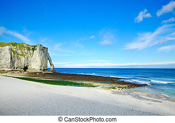 Etretat Aval cliff landmark and its beach Normandy, France -...