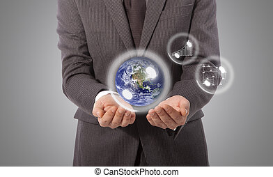 earth globe in hand, Elements of this image furnished by NASA