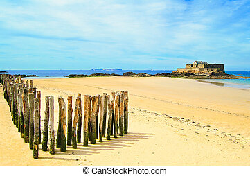 Saint Malo Fort National and poles, low tide Brittany,...