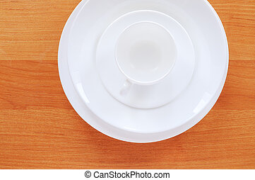 Dinnerware on table - Dinnerware on a table made of wood