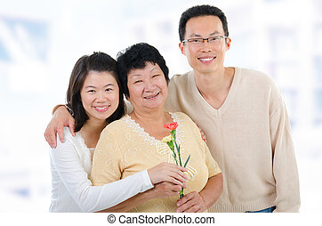 Mothers day at home - Asian family at home Adult offsprings...
