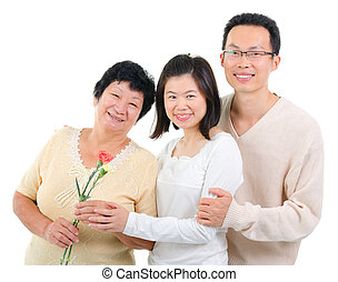 Carnation flower on mothers day - Asian adult offsprings...