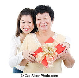 Asian family and gift box - Asian parent and adult offpring...
