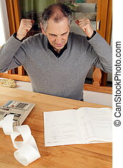 Elder man with calculator and booklet