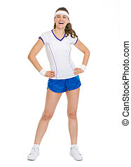 Full length portrait of smiling tennis player