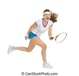 Fierce tennis player hitting ball