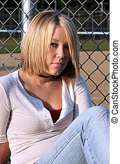 Cautious Blond Woman - Serious young blond woman with a...