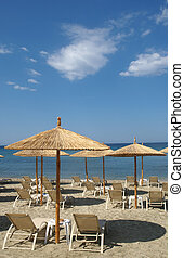 Thassos - Seaside in Greece in summer with umbrella