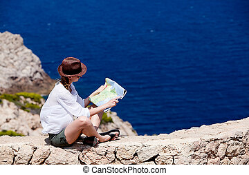young attractive woman with land map in summer holiday...