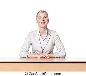 Young business woman sitting at a desk, isolated