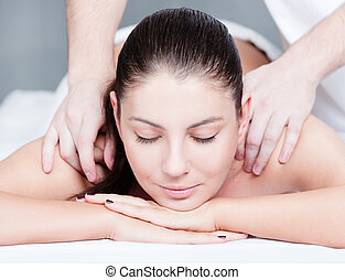 Woman getting massage treatment - Woman receives shoulders...