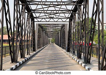 Road through metal bridge tunnel - Modern iron bridge, low...