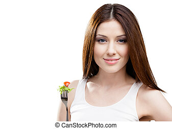 Woman eating fresh salad on a fork - Woman eating salad on a...