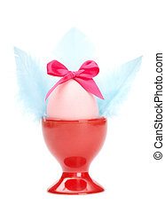 Colored easter egg with pink bow and blue wings