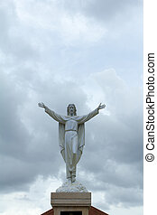 Jesus Christ appears in the clouds.