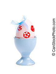 Easter egg with blue bow and printed flowers