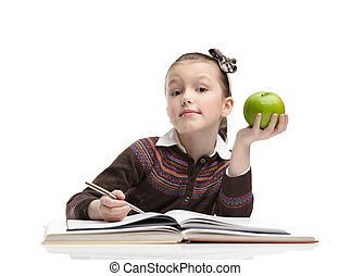 Schoolgirl with a green apple