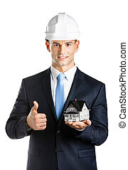 Engineer shows model house and thumbs up