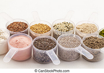 scoops of seeds and powders - scoops of superfood - healthy...