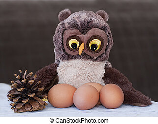 Toy an owl nests with eggs - Brown toy an owl with eggs