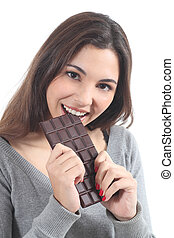 Beautiful woman eating chocolate on a white isolated...
