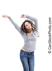 Beautiful woman dancing happy on a white isolated background...