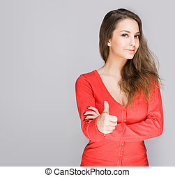 Brunette showing big thumbs up. - Portrait of a cute young...