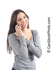 Happy woman talking on mobile phone on a white isolated...