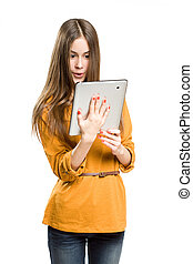 Teen girl using tablet computer. - Portrait of a beautiful...
