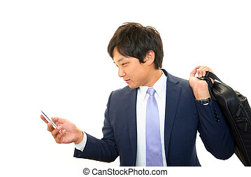 Smart phone with business woman. - Portrait of an Asian...