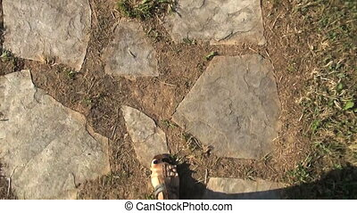 sandals walking on stones path 30 - top view of woman legs...
