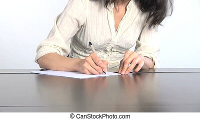 writing wrong letter - white shirt woman on a table writing...